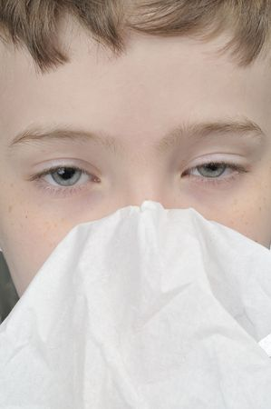 Young boy with a tissue having a cold close up Stock Photo - 5737050