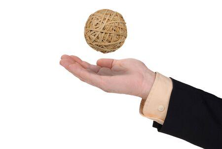 rubberband: Hombre de negocios con bola de rubberband en mano aislado en blanco Foto de archivo
