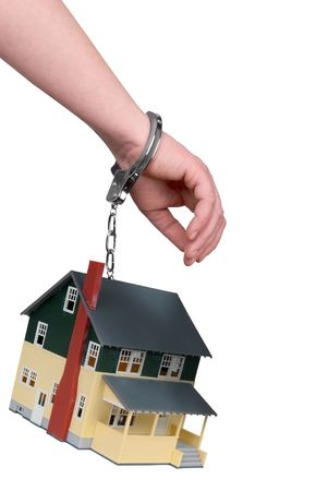 One hand handcuffed to a house isolated over white photo