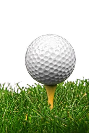 Golf ball close-up from the ground level with grass and white background Reklamní fotografie