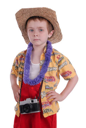 young boy dressed as a funny tropical tourist, isolated