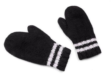 Black mittens with white stripe on wrist over white Reklamní fotografie