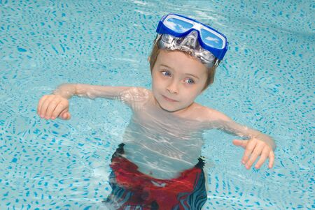handsome young boy in Swimming Pool with googles