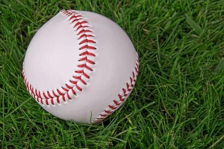 new,clean baseball in a grass background Reklamní fotografie