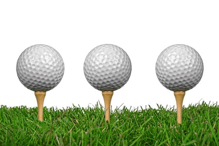 Golf balls close-up from the ground level with grass and white background
