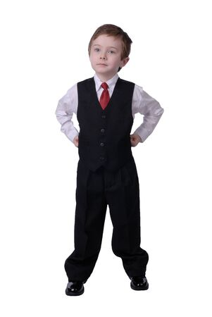 confident handsome attractive young boy dressed in suit looks off to his bright future on white background. photo