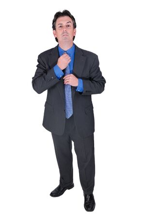 primp: Businessman adjusting his tie isolated over white