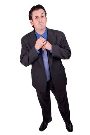 Businessman adjusting his red tie isolated over white