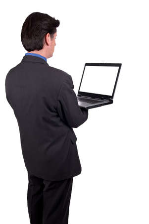 Businesswoman holding a laptop isolated over white