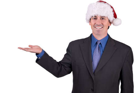 Businessman with a Christmas hat on his head with his hand open isolated over white Reklamní fotografie