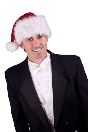 Adult man wearing a Christmas hat and a tuxedo isolated over white Reklamní fotografie