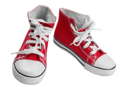 Red classic sneakers isolated over white