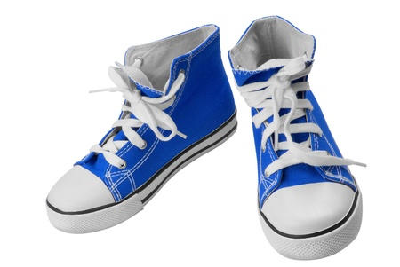 Blue classic sneakers isolated over white  photo