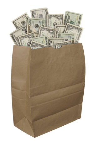 Brown paper bag filled with american money isolated over a white bachground