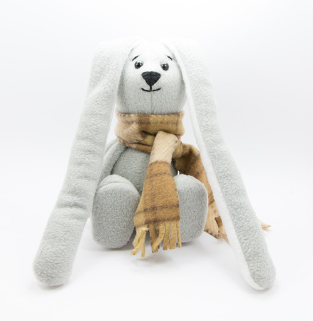 gray: Handmade toy rabbit, gray background
