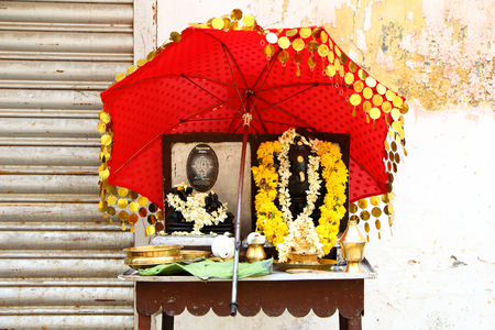 puja: Puja for the gods from the shopkeeper. South India