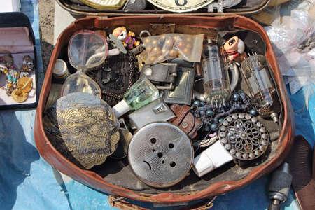 antiques: Antiques in the suitcase. Flea market Stock Photo