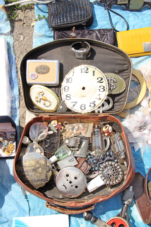 flea market: Antiques in the suitcase. Flea market Stock Photo