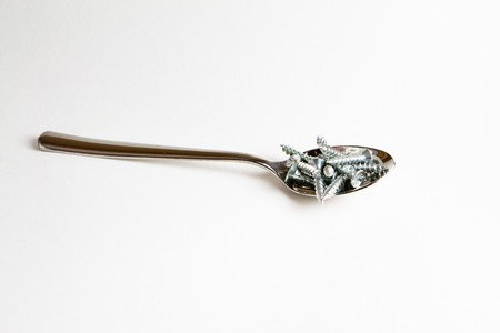 Teaspoon of metal screws photo