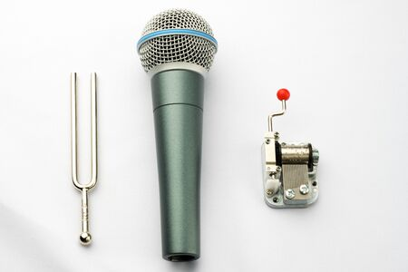 diapason: Music objects  a pitchfork, a microphone and a carillon Stock Photo