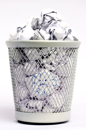 bad idea: Silver colored metal paper bin full of white paper pieces rolled into balls and a bad idea Stock Photo