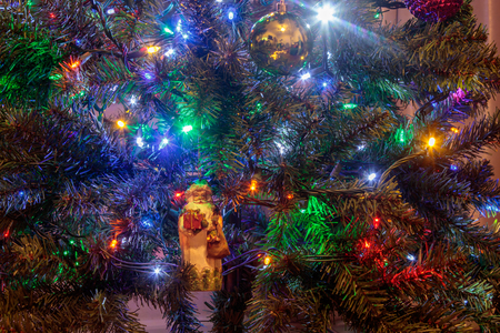 bright christmas decoations on a tree
