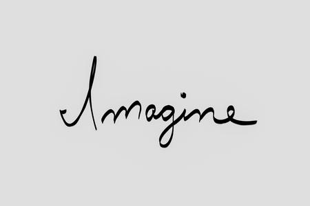 Imagine written in black Фото со стока
