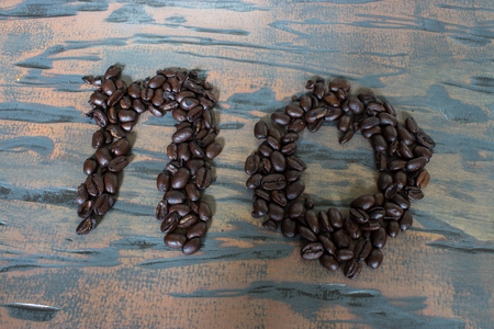no spelled out on wood with coffee beans