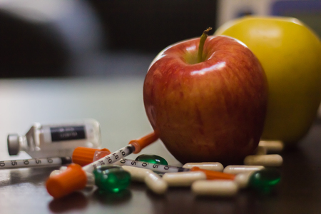 apples surrounded by pills