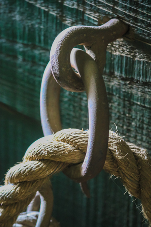 thick rope looped through metal bolt Stock Photo