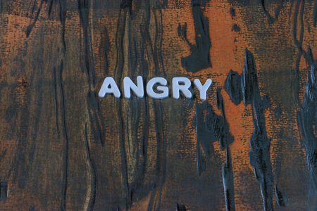 angry written in white lettering