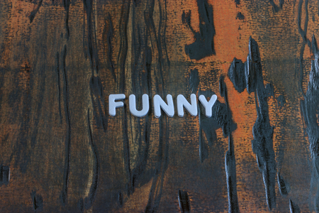 the word funny written in white block letters