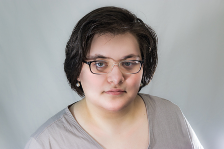 young adult woman with glasses