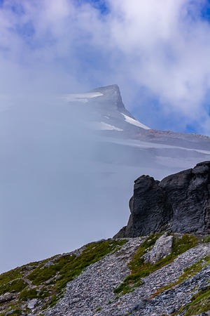 harsh stoney mountain with cold cloud and fog cover 2