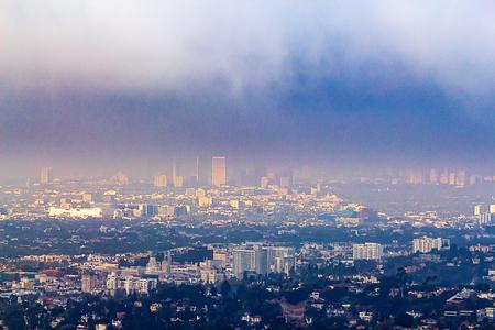 Hillside view of Burbank and Wilshire buildings in haze Banco de Imagens