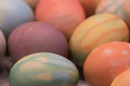 a grouping of many multicolored hard boiled eggs dyed for easter