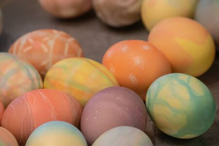 many multicolored eggs with different patterns decorated and dyed