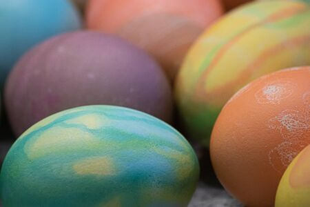 many eggs with different patterns decorated and dyed for easter