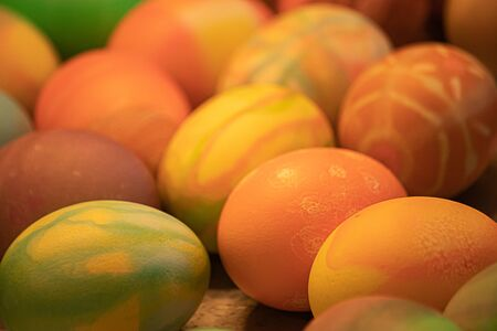 many multicolored eggs with different patterns decorated and dyed for easter