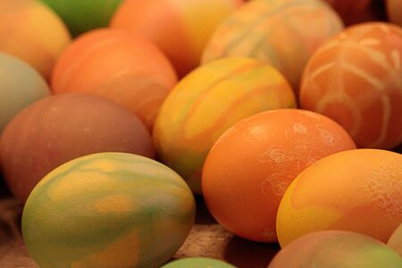 many multicolored hard eggs with different patterns decorated and dyed for easter