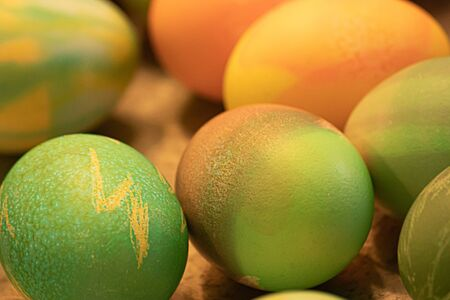 many multicolored eggs with patterns decorated and dyed for easter