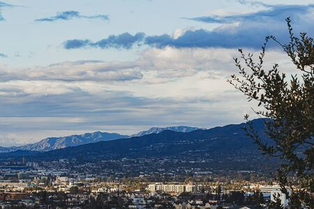 hilltop view of burbank and san fernando valley, san gabriel mountains with cloudscape Imagens