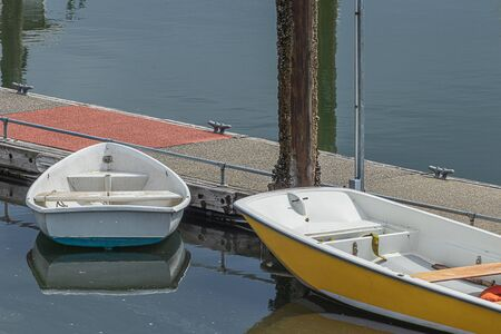 small rental boats docked along wooden walkway out on water Imagens