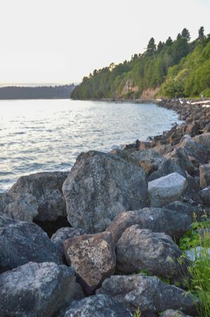 coastline seawall made of large stacked boulders