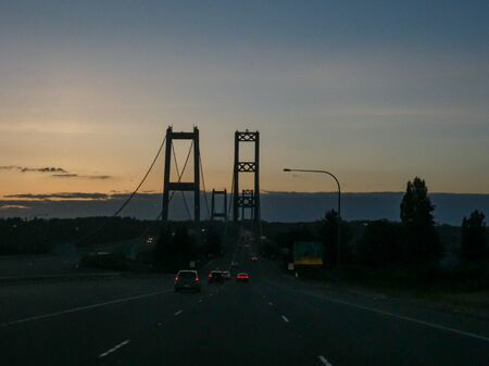 narrows bridge with traffic flowing along at sunset