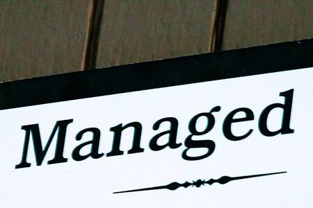sign with black letters on white spelling the word managed