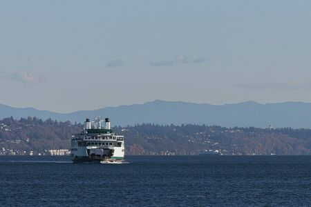 washington ferry on puget sound along the shores of seattle area under blue skys