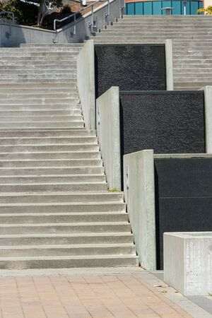 decorative stairs with water feature leading up to a building