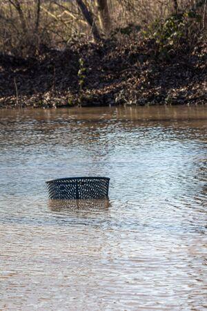 top rim of rubbish bin in flood