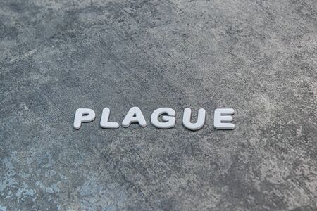 plague written out on gray background with white lettering